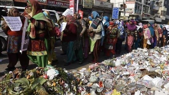 Besides payment of salaries, sanitation workers are also demanding regular jobs.(Sonu Mehta/ HT file photo)