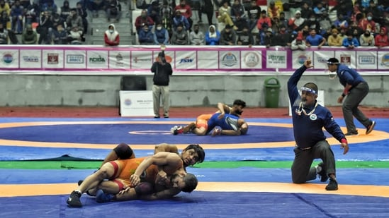 Wrestlers participate in the 65th Senior Men Free Wrestling Championship at Noida Stadium.(ANI Photo)