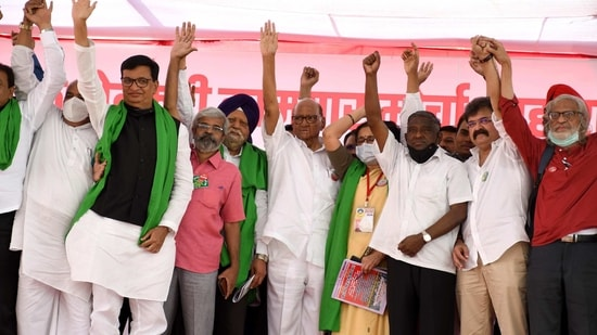 NCP chief Sharad Pawar, Cabinet Minister Balasaheb Thorat, and Chief of Shetkari Kamagr party Jayant Patil waving the gathering of over 6,000 farmers from across 21 districts of Maharashtra for a three-day sit-in at Azad Maidan in solidarity with protesting farmers at the Delhi border against farm laws, in Mumbai on Monday. (ANI Photo)