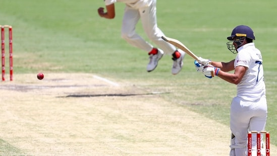 India's Shubman Gill, right, hits a delivery from Australia's Mitchell Starc.(AP)