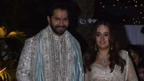 Varun Dhawan and Natasha Dalal stepped out for pictures after their wedding.(Varinder Chawla)