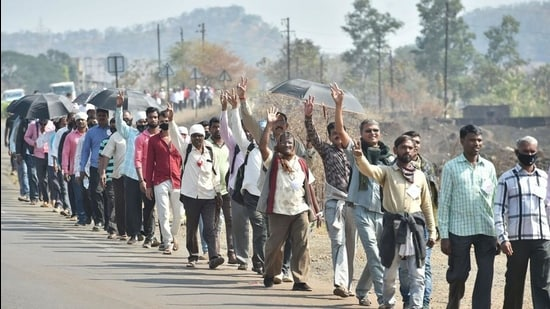 Farmers from Nashik district walk along the Nashik-Mumbai highway to participate in the protest march scheduled to take place on January 25, in Mumbai. (PTI)