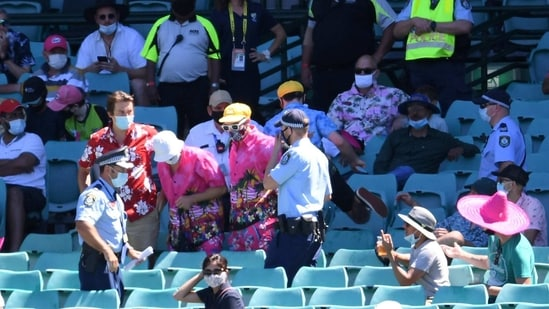 Police remove a group of spectators from their seats after Mohammed Siraj of India complained to umpires of being racially abused during day four of the third test match between Australia and India at the SCG, Sydney, Australia, January 10, 2021.(via REUTERS)