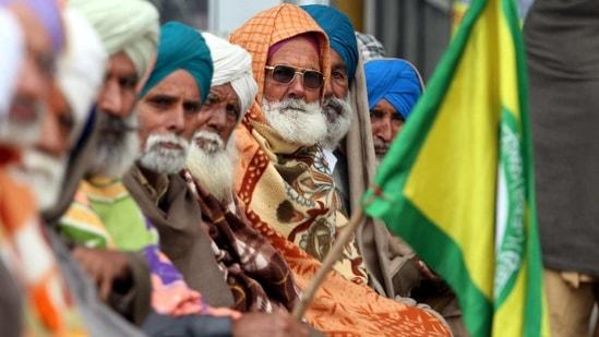 Farmers on a sit-in protest against new farm laws, at Lehra Bega toll plaza in Bathinda, Punjab. (Sanjeev Kumar/Hindustan Times)