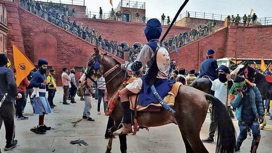 A Nihang Sikh aboard a horse inside Red Fort on Tuesday. (Sanjeev Verma/HT PHOTO)