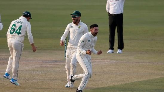 South Africa's spinner Keshav Maharaj, center front, and his teammates celebrate dismissal of Pakistan's Babar Azam.(AP)
