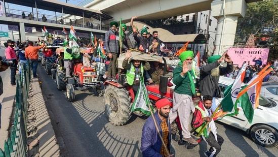 Farmers participate in tractor rally near Nangloi in New Delhi on Tuesday.(PTI Photo)