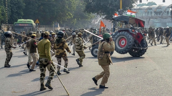 Police lathicharge farmers who were attempting to break barricades at ITO during their 'tractor march' on Republic Day, in New Delhi.(PTI Photo)