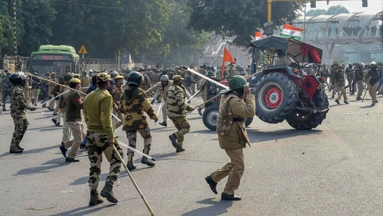 Police lathicharge farmers who were attempting to break barricades at ITO during their 'tractor march' on Republic Day, in New Delhi on Tuesday.(PTI Photo)