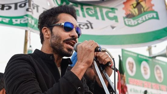 Actor Deep Sidhu addresses farmers at Ghazipur in New Delhi. (PTI)