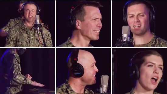 The image shows members of the US Navy Band wearing headphones as they take turns singing lyrics of Taylor Swift's song into the microphones.(Twitter/@usnavyband)