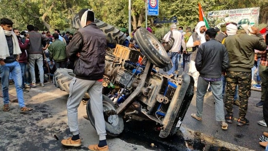 The overturned tractor in Delhi under which the body of a farmer was found on Tuesday.(HT Photo)