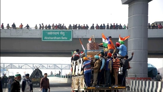 Farmers at NH-24 Akshardham Ring Road in New Delhi on Tuesday, January 26. (ANI)