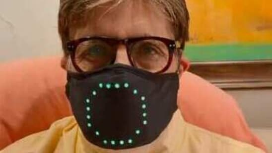 Amitabh Bachchan shows off his new mask.