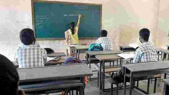 Student maintain social distancing in class after schools reopened more than 9 months after they were closed due to Covid-19.(HT PHOTO)