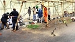 Farmers remove tents from a protest site at the Ghazipur border on Wednesday.(Sakib Ali/HT Photos)