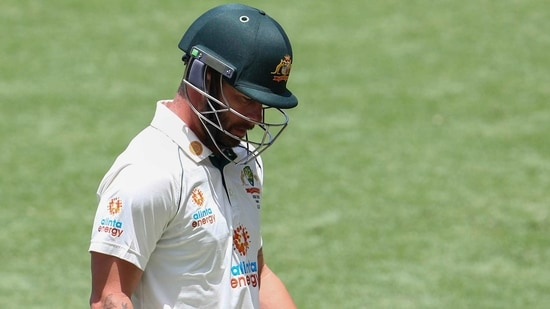 Australia's Matthew Wade walks from the field after he was dismissed without scoring during play on day four of the fourth cricket Test between India and Australia at the Gabba, Brisbane.(AP)