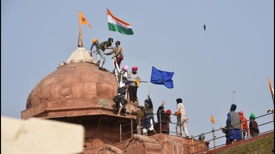 India is witnessing an economic transition, social change, the rise of Hindutva and increasing support for a strong Centre. The attempt to hoist a flag at the Red Fort is a symbol of the battle over the nature of the State (PTI)