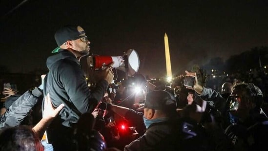 Proud Boys Chairman Enrique Tarrio addresses supporters of U.S. President Donald Trump and other members of the far-right Proud Boys during a march near the Washington Monument the night before rallies to protest the U.S. presidential election results, in Washington, D.C., U.S., December 11, 2020. REUTERS/Jim Urquhart/Files(REUTERS)