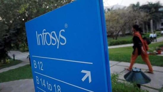 An employee walks past a signage board in the Infosys campus at the Electronics City IT district in Bangalore(Reuters)