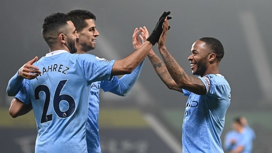 Premier League - West Bromwich Albion v Manchester City - The Hawthorns, West Bromwich, Britain - January 26, 2021 Manchester City's Raheem Sterling celebrates scoring their fifth goal with teammates (Pool via REUTERS)