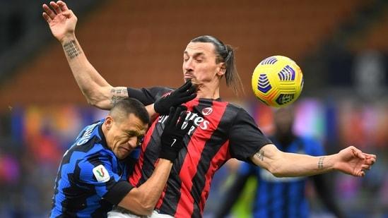 Inter Milan v AC Milan - San Siro, Milan, Italy - January 26, 2021 Inter Milan's Alexis Sanchez in action with AC Milan's Zlatan Ibrahimovic (REUTERS)