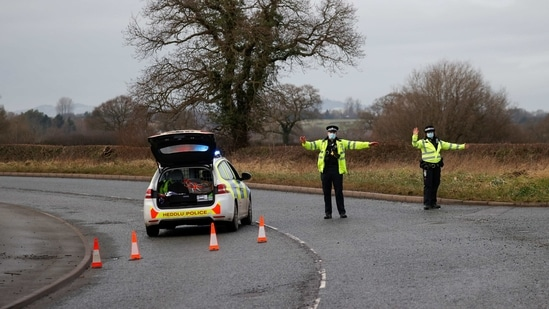 Police officers manage a checkpoint on a road near the Wockhardt pharmaceutical plant in Wrexham, Britain January 27, 2021. REUTERS/Phil Noble(REUTERS)