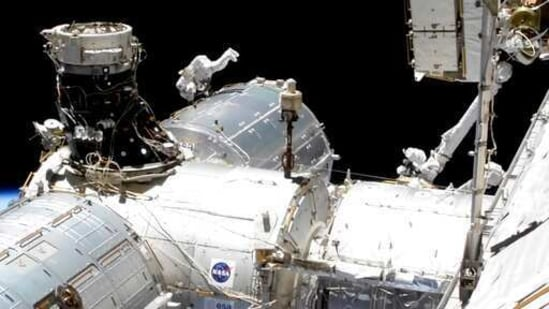 In this image taken from NASA video, NASA astronaut Mike Hopkins works outside the International Space Station's European lab on Wednesday, Jan. 27, 2021. Hopkins and Victor Glover went spacewalking Wednesday to install a high-speed data link outside the International Space Station's European lab and connect cables for an experiment platform awaiting activation for almost a year. (NASA via AP)(AP)