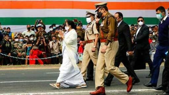 Mamata Banerjee, Chief Minister of eastern Indian state West Bengal greets the audience as she arrives to attend the Republic Day ceremonial parade in Kolkata, India, Tuesday, Jan. 26, 2021. Republic Day marks the anniversary of the adoption of the country's constitution on Jan. 26, 1950. (AP Photo/Bikas Das)(AP)