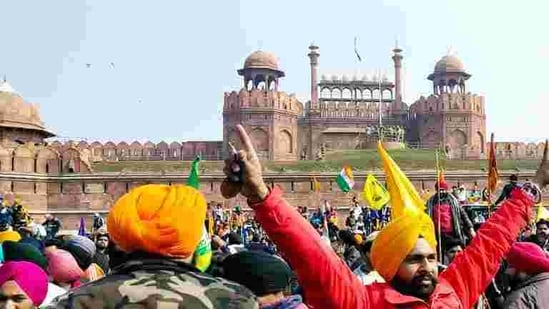 Farmers reach Red fort during their tractor rally on Republic Day, in Delhi . (ANI)