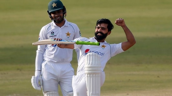 Pakistan's Fawad Alam celebrates after scoring a century during the second day of the first cricket test match between Pakistan and South Africa at the National Stadium, in Karachi(AP)