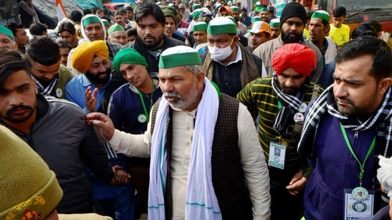 New Delhi: BKU spokesperson Rakesh Tikait along with farmers during their ongoing protest against the new farm laws, at Ghazipur border in New Delhi, Monday, Jan. 25, 2021. (PTI Photo/Ravi Choudhary)(PTI01_25_2021_000121A)(PTI)
