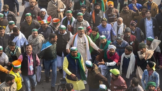 BKU spokesperson Rakesh Tikait with farmers at Ghazipur border ahead of the 'Kisan Gantantra Parade' in protest against Centre's farm reform laws, on the occasion of 72nd Republic Day, in New Delhi.(PTI)