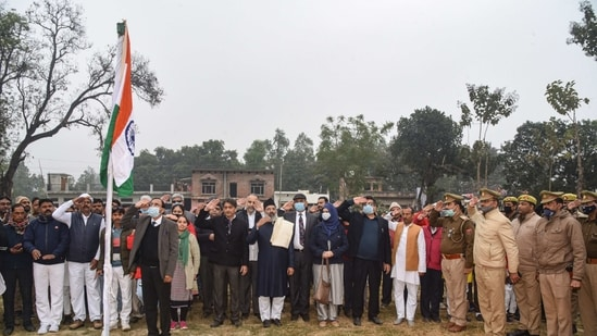 Ayodhya: A flag hoisting ceremony on the occasion of the Republic Day before the symbolic foundation stone laying for the construction of a mosque in the 5 acre land, which has been alloted after the Supreme Court verdict on Ram Janmabhoomi-Babari Masjid case, at Dhannipur, Tuesday, Jan. 26, 2021. (PTI Photo)(PTI01_26_2021_000291B)(PTI)
