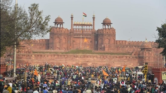 Farmers gather at Red Fort during their tractor parade on Republic Day, in New Delhi. (PTI)