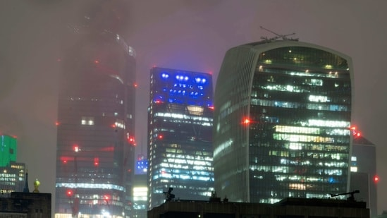 View of buildings in the City financial district of central London in the rain during England's third national lockdown to curb the spread of coronavirus( AP)