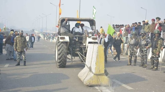 A video of an unruly tractor moving waywardly towards police personnel at ITO emerged on Tuesday as farmers protesting against farm laws deviated from their route and moved inside the Capital.