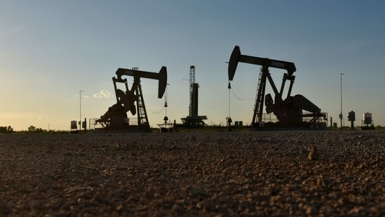 Pump jacks operate in front of a drilling rig in an oil field in Midland, Texas US.(Reuters File Photo )