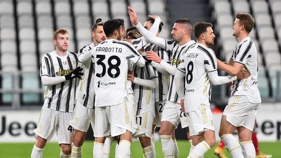 Juventus' Alvaro Morata celebrates scoring their first goal with teammates.(REUTERS)