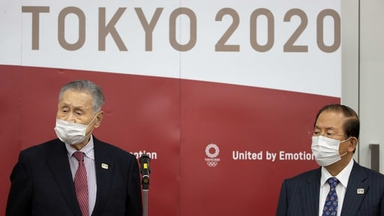 Tokyo Olympic and Paralympic Games Organising Committee (TOGOC) President Yoshiro Mori (L) and CEO Toshiro Muto speak to the media after a video conference with IOC President Thomas Bach at the TOGOC headquarters in Tokyo, Japan January 28, 2021.(REUTERS)