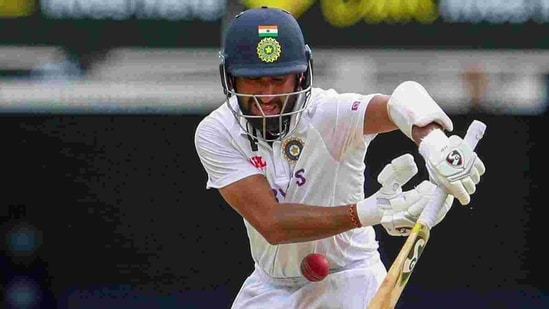 India's Cheteshwar Pujara plays at the ball during play on the final day of the fourth cricket test between India and Australia at the Gabba.(AP)