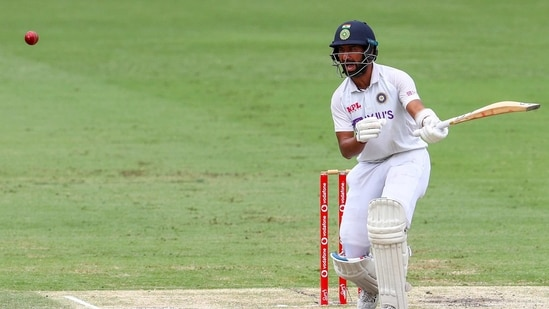 India's Cheteshwar Pujara reacts as he bats during play on the final day of the fourth cricket test between India and Australia at the Gabba, Brisbane.(AP)