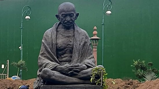 New Delhi: Statue of Mahatma Gandhi relocated in between Gate No 2 and 3 of Parliament House for the ongoing construction of the new Parliament building, in New Delhi, Tuesday, Jan. 19, 2021. (PTI Photo)(PTI01_20_2021_000192A)(PTI)
