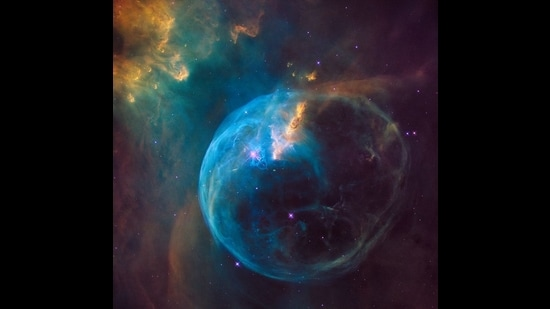 An image of the Bubble Nebula taken by NASA's Hubble space telescope. It's 7,100 light years away, in the constellation Cassiopeia, and has a star 45 times the size of our sun. The bubble is formed by strong solar winds pushing interstellar gasses around. (NASA, ESA, and the Hubble Heritage Team (STScI/AURA))