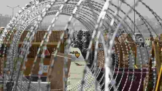 Barbed wire put across a road at Ghazipur border during the farmers' protest, in New Delhi. (PTI Photo)