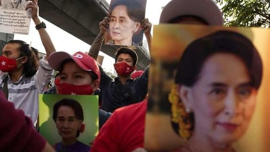 Suu Kyi and President Win Myint were detained in the capital Naypyidaw before dawn, party spokesman Myo Nyunt told AFP. In picture - Supporters rally outside Myanmar's embassy in Bangkok, Thailand.(Reuters)
