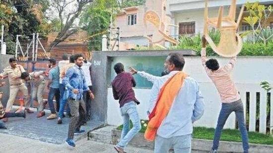 BJP workers attacking the residence of Telangana Rashtra Samithi MLA Challa Dharma Reddy in Warrangal on Sunday(HT PHOTO)