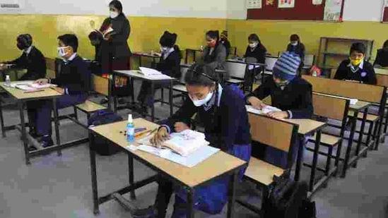 Students attending classes at GMSSS, Sector 33, Chandigarh, on Monday. (Keshav Singh/HT)