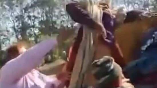 A homeless woman in Indore is being hauled into a truck during homeless person's eviction drive. (Editorji/Twitter)