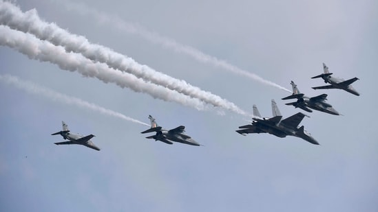 Sukhoi Su-30MKI fighters and Advanced Jet Trainer Hawk aircrafts perform during the first day of the Aero India 2021 Airshow at the Yelahanka Air Force Station in Bangalore. (AFP)